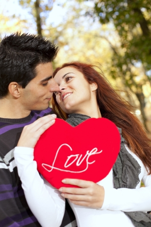 Love and affection between a young couple at valentine day (selective focus with shallow DOF) Stock Photo