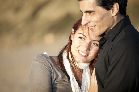 Love and affection between a young couple in outdoor (selective focus with shallow DOF) photo