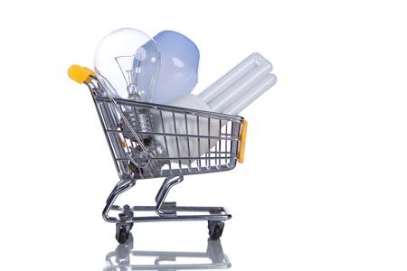 halogen lighting: Shopping cart with light bulbs inside (isolated on white) Stock Photo