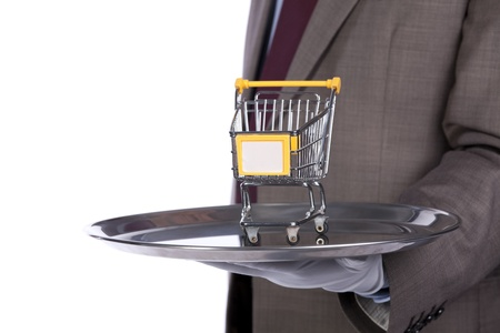 businessman showing you a shopping solution photo