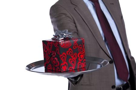 Businessman holding a luxury valentine present in silver platter photo