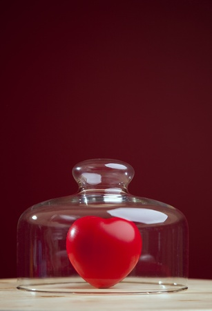 Red heart inside a glass dome (selective focus) photo