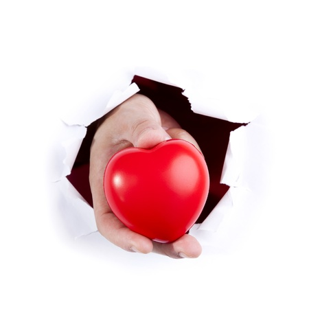 Hand breaking a white paper showing a red heart photo