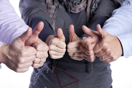 Group of people gesturing OK with his hands (selective focus) photo