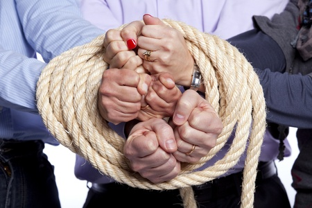 Group of hands arrested with a rope photo