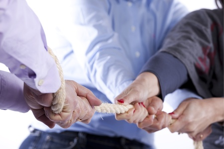Group of woman hands pulling a rope competing with a man (selective focus) Stock Photo - 9272763