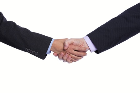 men shaking hands: Businesspeople hands doing a handshake (selective focus) Stock Photo