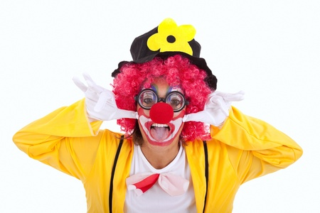 Funny crazy clown with a strange face (isolated on white) photo
