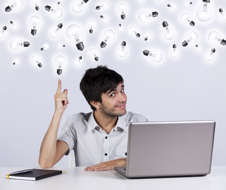 Young man with lots of ideas in the office working with his laptop Stock Photo - 9288604