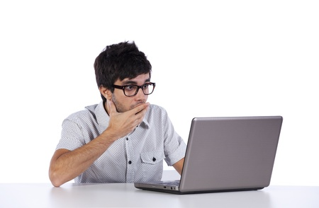 young man shocked with something he see on his laptop computer photo