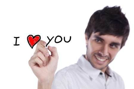 Young happy man writing a love message on the whiteboard (selective focus) Stock Photo - 9288159