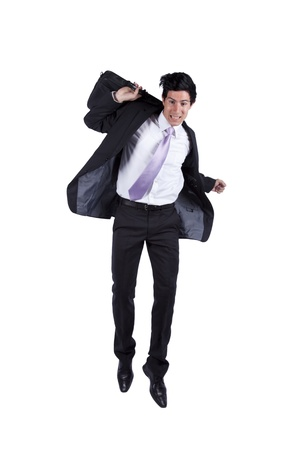 young happy businessman jumping isolated on white (some motion blur) photo