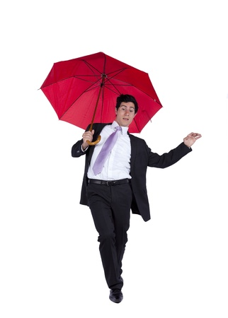 businessman covering him self by a red umbrella photo