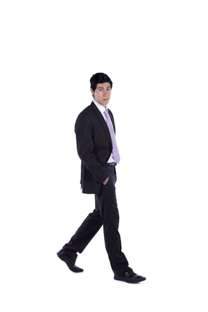 Businessman walking isolated on white (some motion blur) Stock Photo