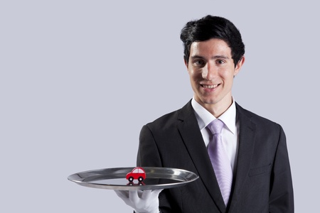 happy businessman showing you car services solutions Stock Photo - 9280120