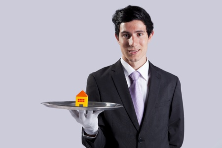 happy businessman showing you house services solutions photo