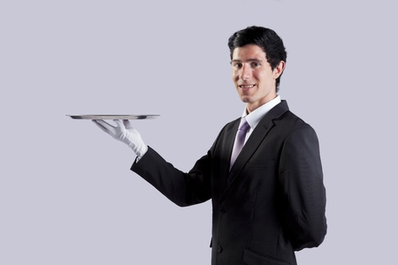businessman showing you the solution (copyspace over the tray) photo