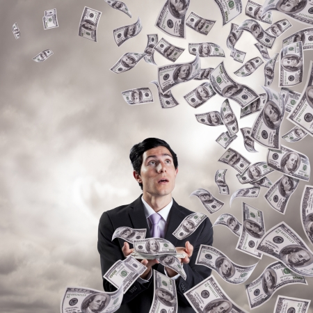 jackpot: businessman loosing money from his hands (isolated on white) Stock Photo