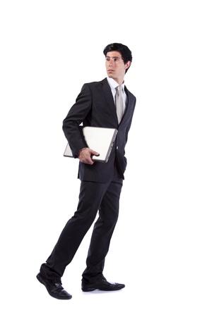 walking alone: Empresario caminando y mirando atr�s aislados en blanco (algunos desenfoque de movimiento)