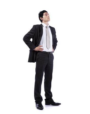 persona de pie: Exitoso hombre de negocios buscar el espacio de copia (aislados en blanco) Foto de archivo