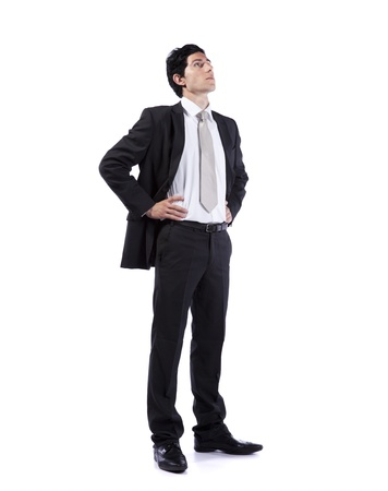 look up: Successful businessman looking up to the copy space (isolated on white)