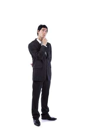 Young businessman thinking and looking up (isolated on gray) Stock Photo - 9280118