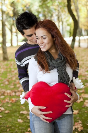Love and affection between a young couple at valentine day (selective focus with shallow DOF) Stock Photo - 9285816