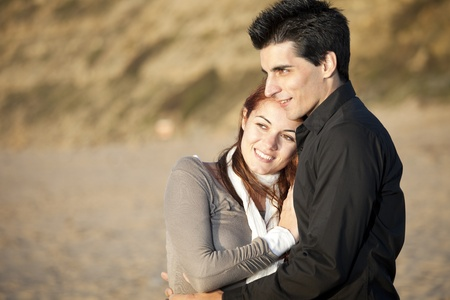 romantic hug: Love and affection between a young couple in outdoor (selective focus with shallow DOF) Stock Photo