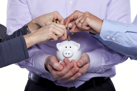 Group of business people saving money on the piggybank Stock Photo - 10030561