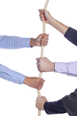 tug: Group of woman hands pulling a rope Stock Photo