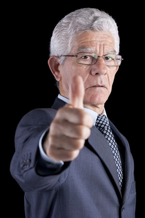 Businessman gesturing OK with his thumb (isolated on black) Stock Photo - 10029991