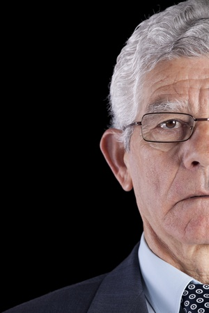 Half face from a senior Businessman isolated on back