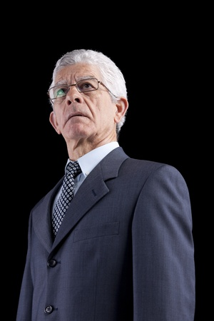 Powerful businessman portrait (isolated on black) photo
