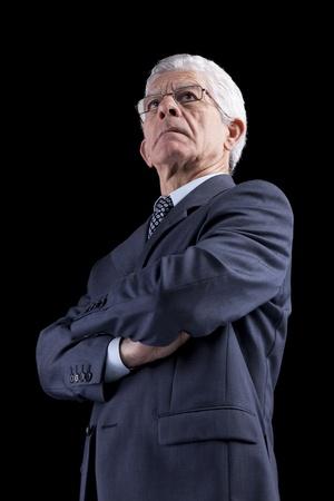 Powerful businessman portrait (isolated on black) Stock Photo
