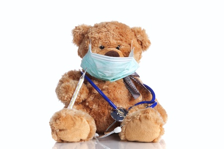 sick teddy bear: Teddy bear looking like a doctor (isolated on white)