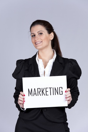 marketing target: Happy businesswoman showing a paper with the word marketing
