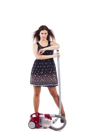 house maid: Modern and sexy young housewife posing with the vacuum cleaner (isolated on white) Stock Photo