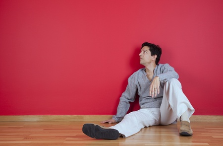 sited: young men sited in the floor of his new house Stock Photo