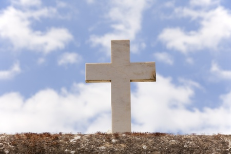 Stone cross with a background sky Stock Photo - 10030079