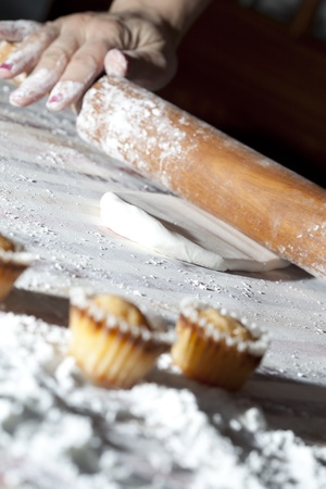 cakes and pastries: Baker preparing the pastry to make small cakes (selective focus) Stock Photo