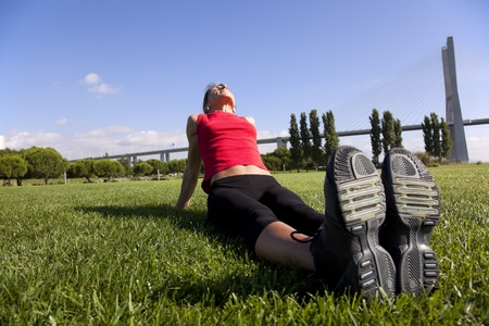 young woman doing some exercise at the park photo