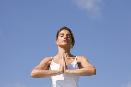 young woman enjoying nature in a yoga pose Stock Photo - 10029769