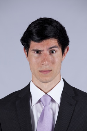 Young businessman with a suspicious look photo