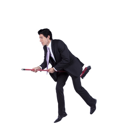 Young businessman flying a broom (isolated on white) Stock Photo - 10029549