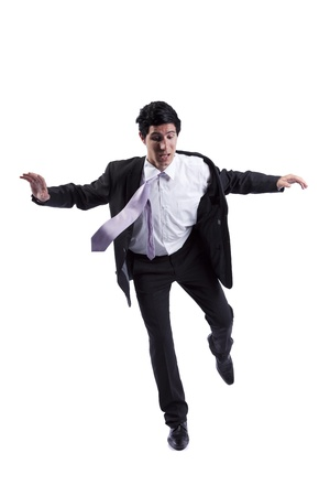 man flying: Scared businessman in a falling position (isolated on white)