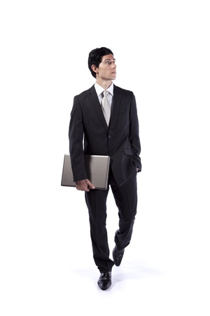 Businessman walking and looking up (isolated on white) Stock Photo