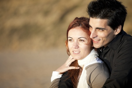 young love: Love and affection between a young couple in outdoor (selective focus with shallow DOF) Stock Photo