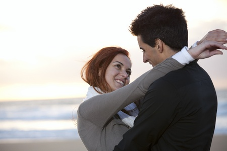Love and affection between a young couple in outdoor (selective focus with shallow DOF) Stock Photo