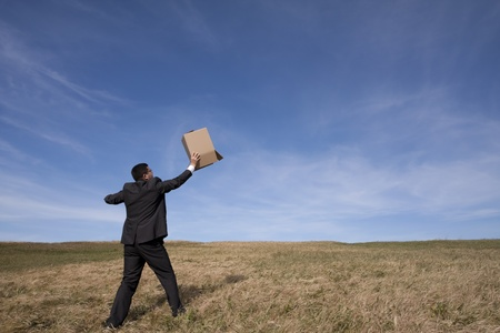 businessman with an open box at the field photo