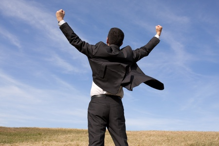 excited man: businessman showing his success at the field